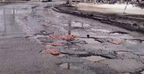repairing-potholes-in-russia-(7)